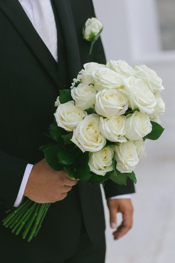 Different than your average all white rose bouquet