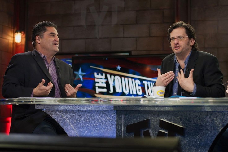 Cenk Uygur and Ben Mankiewicz making a point with their hands.