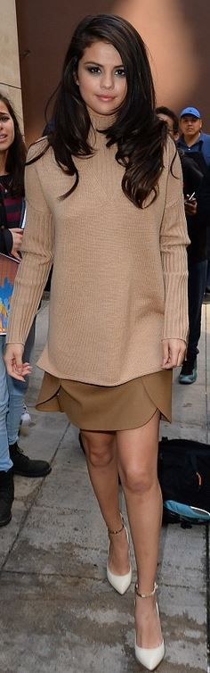 Who made Selena Gomez's tan sweater, pumps, and scallop beige skirt?