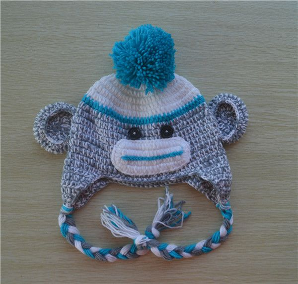 Your little one will sure look adorable in this hand crocheted sock monkey hat. Perfect for everyday use as well as special occasions, or to use as a photography prop! An excellent idea for a gift. Co