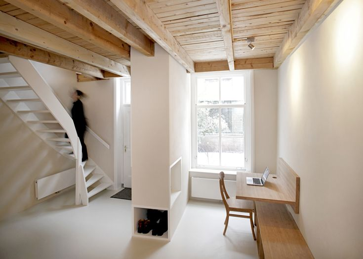 Unknown Architects adds wooden furniture and staircase to old house