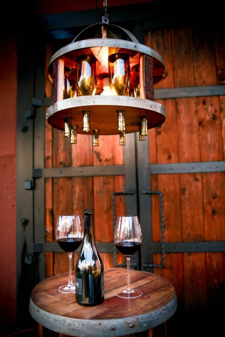 Wine barrel chandelier bottle wine bottle chandelier for How to make a bottle chandelier