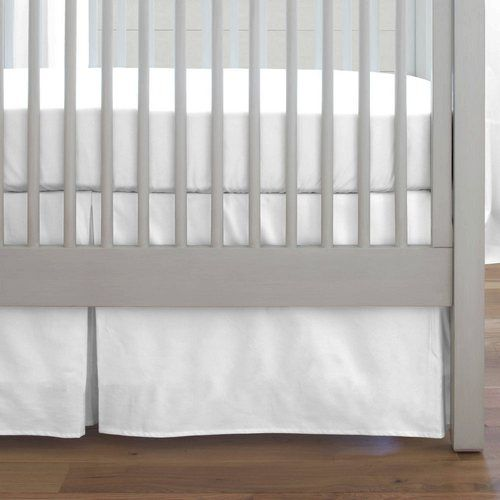 Crib Dust Ruffle in Solid White by Carousel Designs.