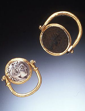 rings ancient coins set in 18k gold swivel settings to showcase both sides