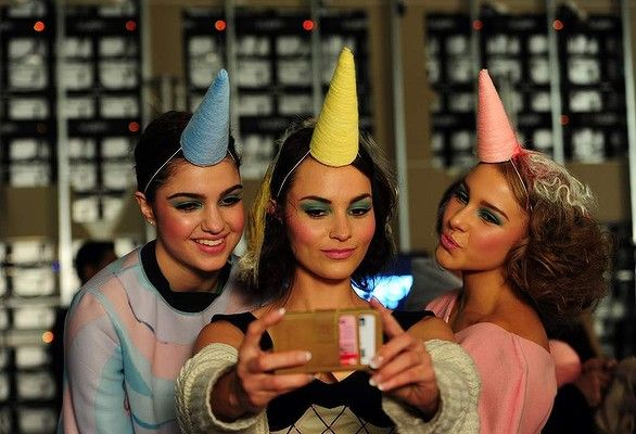 Models llaina Davies, Charne Esterhuizen and Angelina Leljak have some fun before the opening night of Fashfest Photo: Melissa Adams