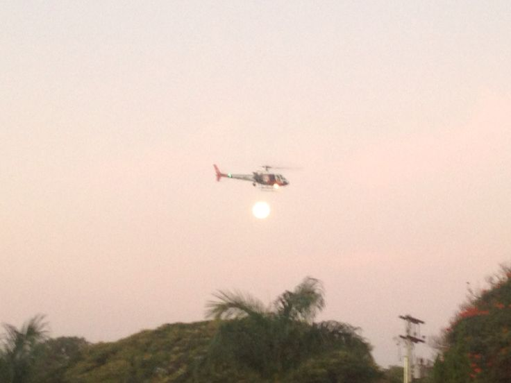 Police helicopter hovering over the festival
