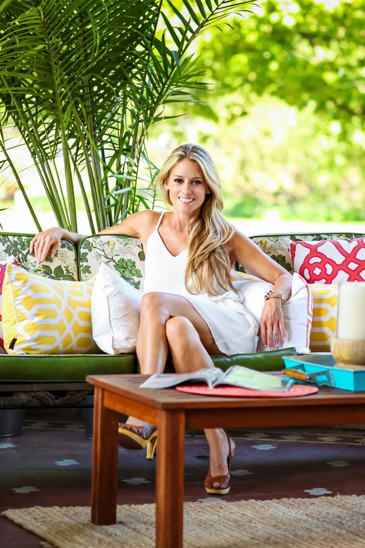 Nicole Curtis, host of DIY Network's Rehab Addict, relaxes on the front porch of the finished patio at the Summit Avenue mansion