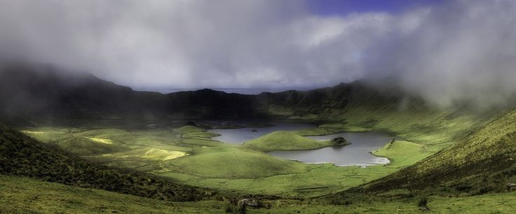 """Corvo Island, Azores, Portugal On the small island of Corvo, the extinct volcanic mountain is crowned with a large subsidence crater, named locally as """"Caldeirão"""" (The Cauldron). With a perimeter of 3,7 km and 300 meters deep the cauldron lodges inside a lake of irregular shapes where the imagination and the will of the locals, after dispelled the mists, recognizes a replica of seven of the nine islands of the Azorean archipelago in the shapes of the cones of the peatlands. The """"Caldeirão""""…"""