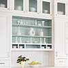 paint the inside of the shelves turquoise? or the same as the walls? or get sample jar of a bolder shade of the same color?