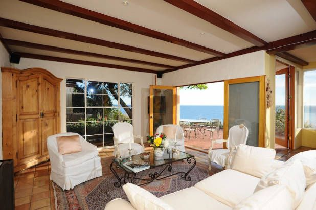 Denzel Washington If you're looking for amazing ocean views, look no further than Denzel Washington's former three-bedroom, two-bathroom Malibu home. It features a detached gym, ocean and mountain views, a guest house, and a pool and jacuzzi. Jimmy Page and Jan-Michael Vincent were also former owners of this retreat. Rate: $490 per night