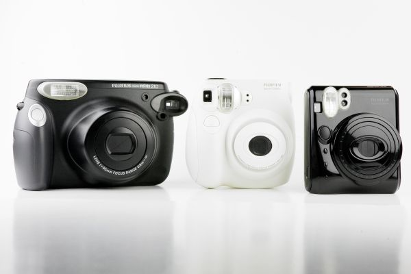 Fuji Instax instant cameras... from left to right you have the 210 wide, 7s mini, and 50's mini piano black? anyway... all amazing... They also have a newer version of the 7s called instax 25. $80- 210, $90- 7s, $125- 25, $149- 50's mini