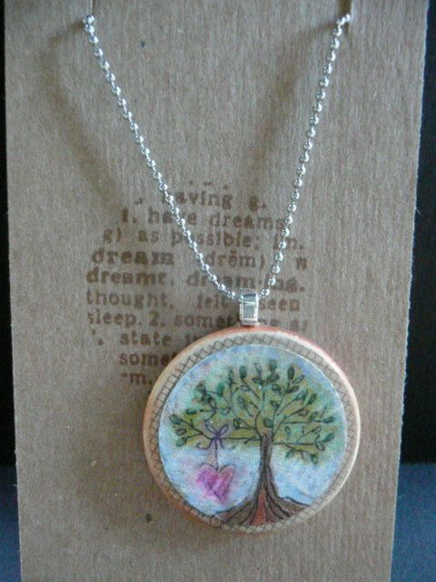 wooden nickle necklace  tree with hangng heart by ThePaperRabbit