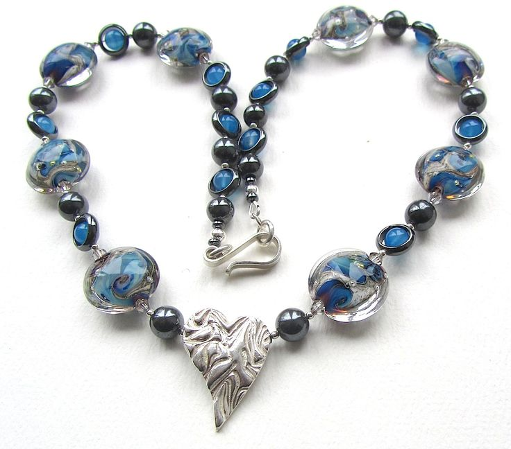 'True Blue Heart' features lampwork by Sally Carver, a silver heart by Becci Crabtree and a handmade hook clasp by George Harper. Proper grownup stringing with top-of-the-range artisan materials