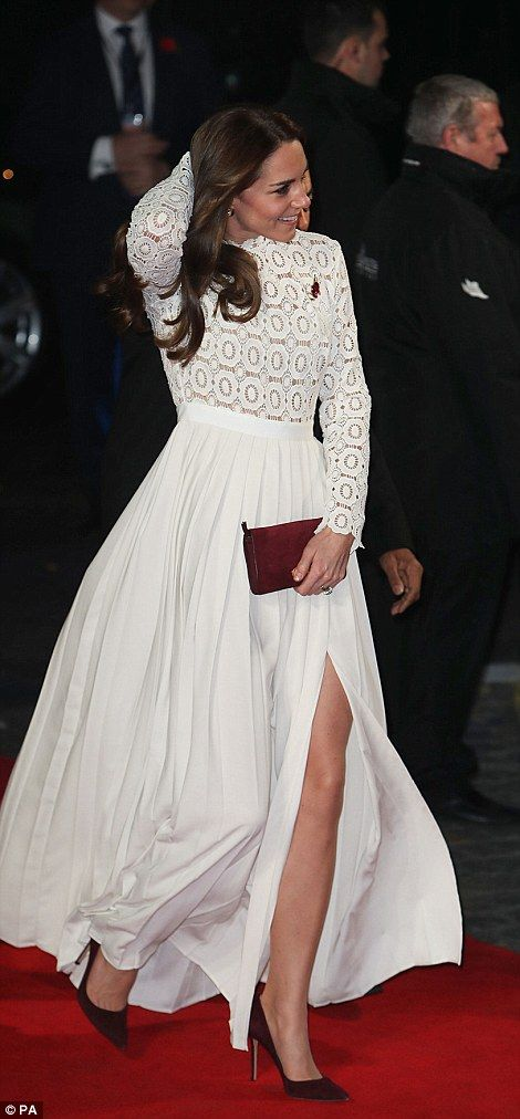 The royal reached around to adjust her tousled locks