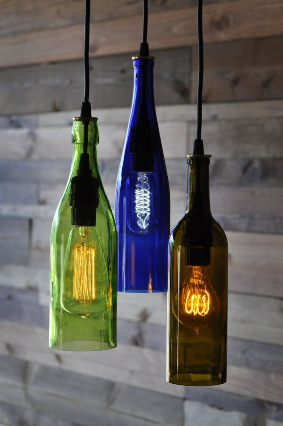 This is a 3) light chandelier made from three different recycled wine bottles - cobalt blue, green and olive colored glass. There is a variety of