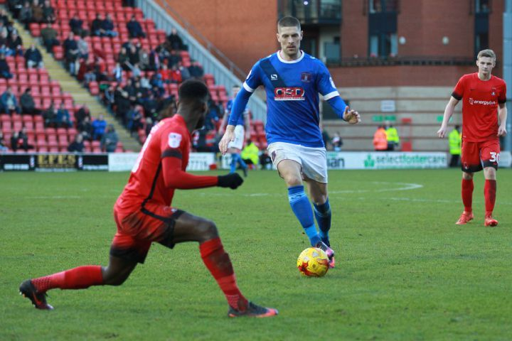 Jamie Proctor in action against Leyton Orient