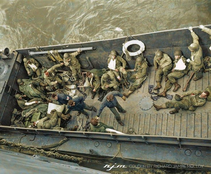 Wounded American soldiers are attended to by medics on a coast guard landing barge alongside an assault transport's sick bay in the English Channel on June 16, 1944. Colour By Richard James Molloy