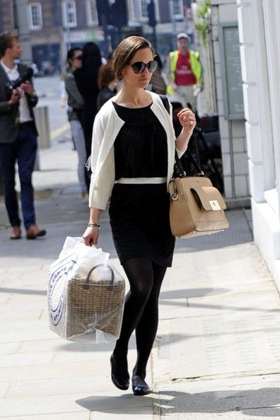 Pippa Middleton stuck to a fashion staple when she wore this little black dress with a white belt and matching cardigan while out shopping.