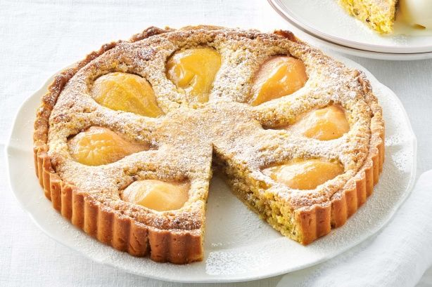 End the night to rave reviews with this decadent Poached pear and pistachio frangipane tart.