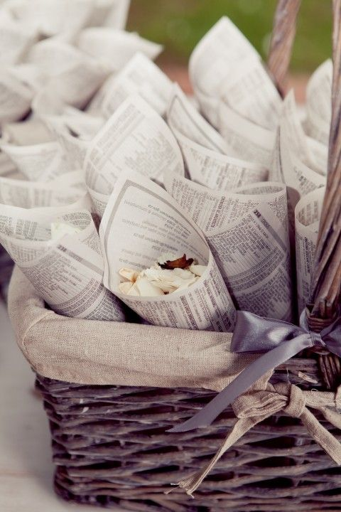 Vintage Romance Wedding Theme - Lucy made her own confetti cones using recycled paper from an old phone book.