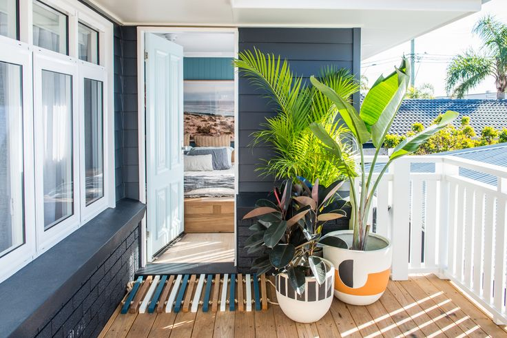Kyal and Kara's outdoor deck reveal on Toowoon Bay Reno. Wideline windows and doors. www.wideline.com.au