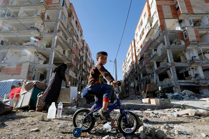 TOPSHOT - An Iranian boy rides a bicycle through the rubble past damaged buildings in the town of Sarpol-e Zahab in Iran's western Kermanshah province near the border with Iraq, on November 14, 2017, following a 7.3-magnitude earthquake that left hundreds killed and thousands homeless two days before. / AFP PHOTO / ATTA KENARE        (Photo credit should read ATTA KENARE/AFP/Getty Images) via @AOL_Lifestyle Read more…