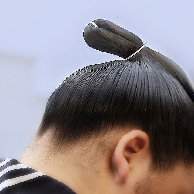 Why do sumo wrestlers wear their hair in a topknot style? Answer: http://www.amazon.com/dp/B006C1I5K8