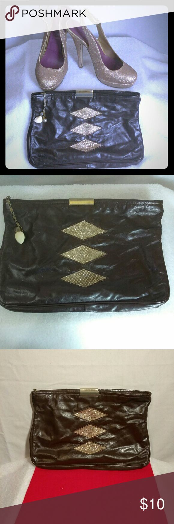 Glam Style Brown Clutch Bag I took a worn out clutch bag and created a new simple yet glamorous look. Purse $10. Shoes are not for sell. This product is a pre-owned item. It may some blemishes. Bags Clutches & Wristlets