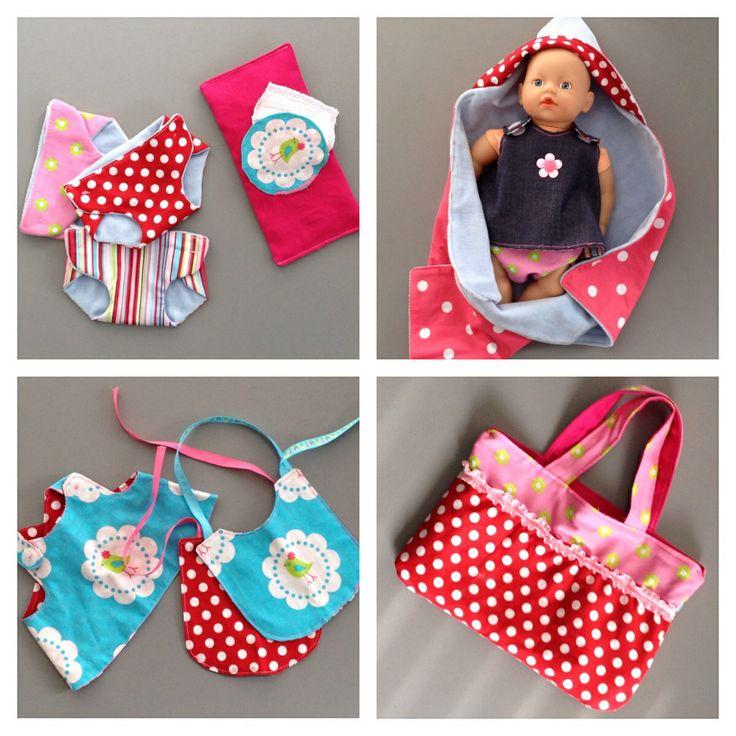 Poppen baby uitzet; luiertas, luiers, luierdoekjes, jurkje, slab en badcape.