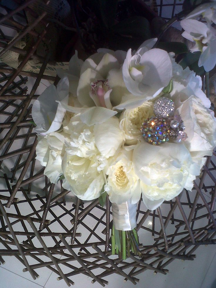 Bridal bouquet made with David Austin roses,Duches de Nemours peonies,white phalaenopsis orchid and white cymbidium orchid