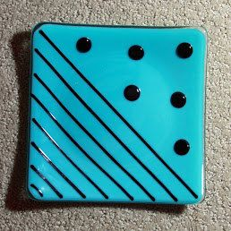 Retro green turquoise with black circles and stripes fused glass plate via Etsy