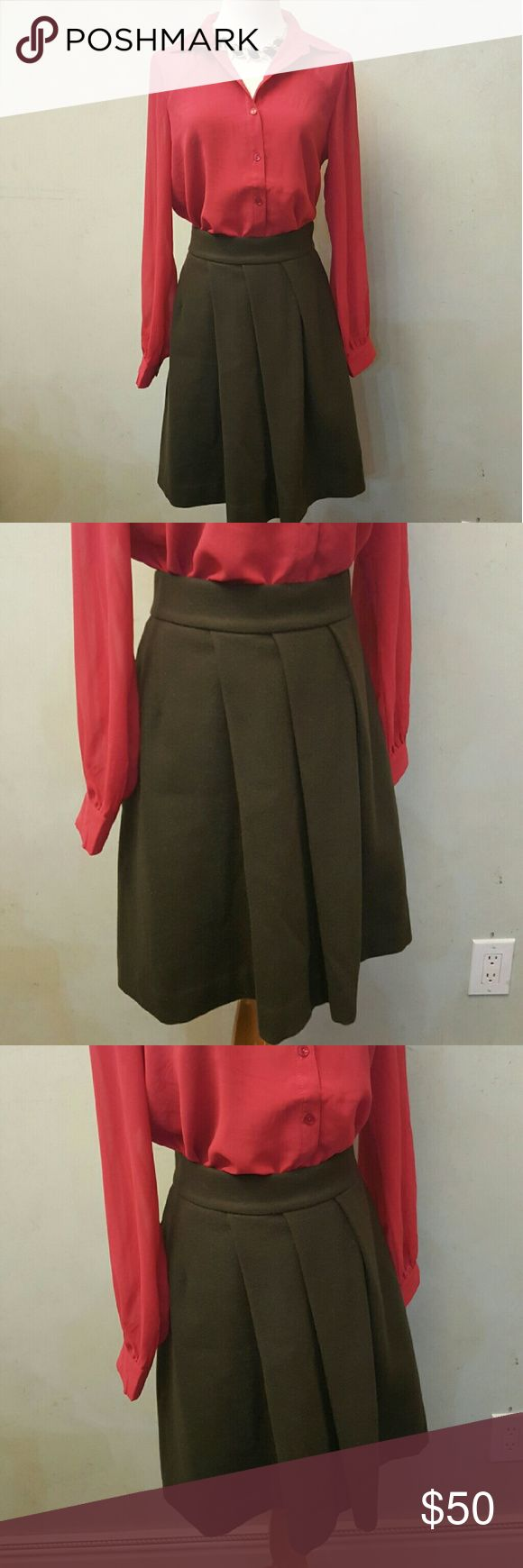 Brown J+ wool skirt In perfect condition like new,  J+ ( Uni Qlo ) brown wool skirt. 21in. Long. Top is in a different listing. Uniqlo Skirts Midi