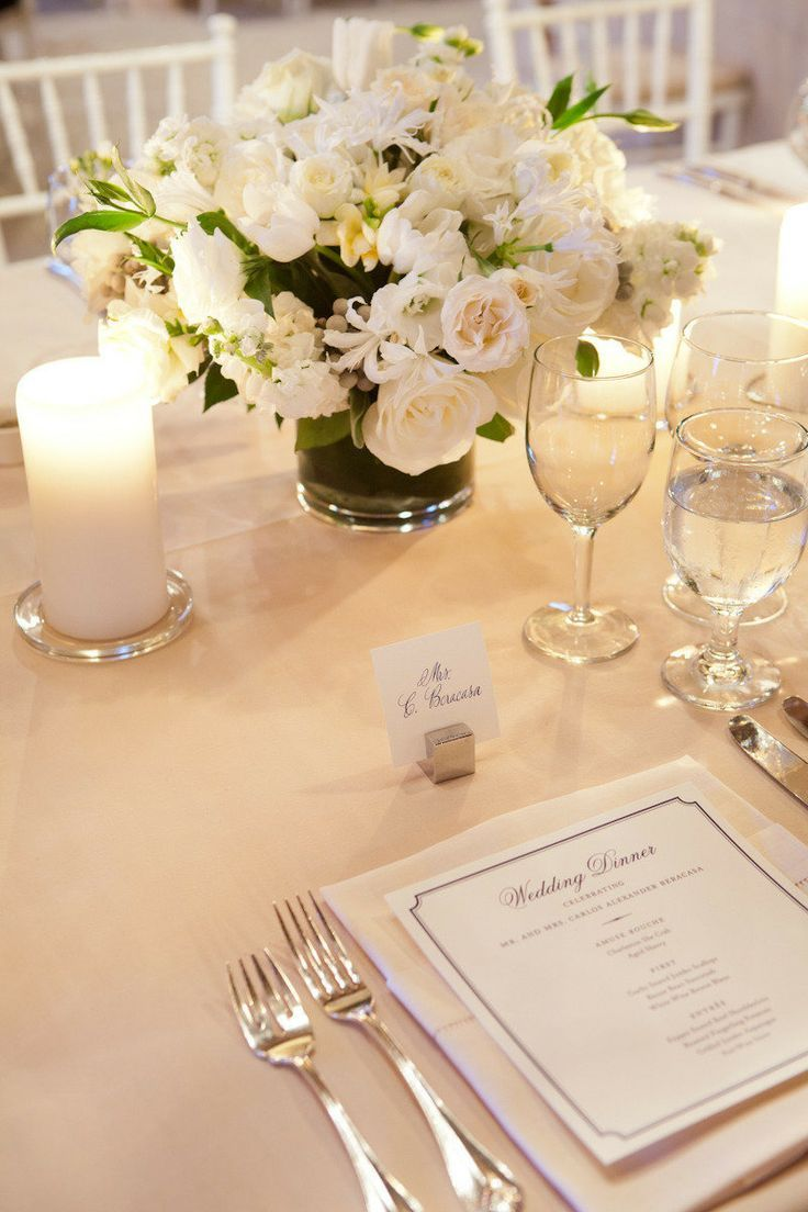 FOR THE TRADITIONAL BRIDE: An all white floral centerpiece for a formal wedding reception | Photo via Mod Wedding