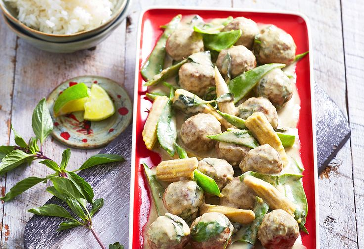 Curried pork mince meatballs taste delicious in this green curry with coconut milk, baby corn and snow peas. Fresh Thai basil gives a zap of finishing flavour.