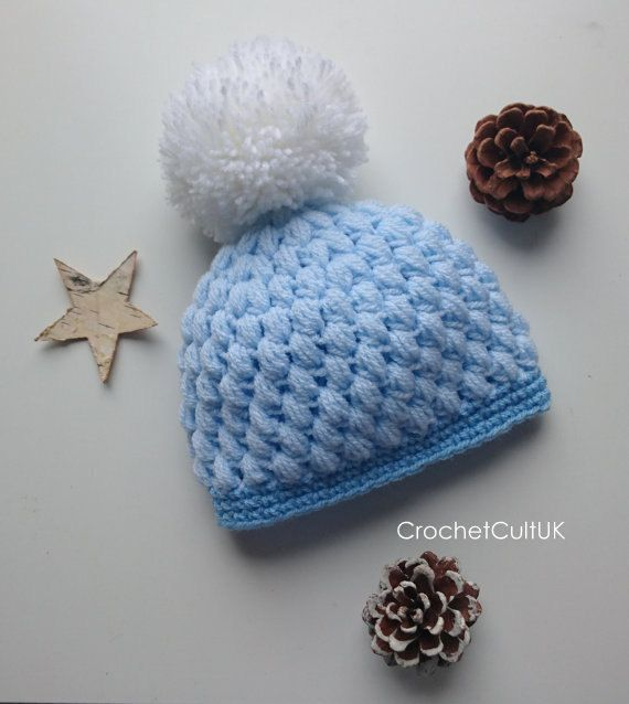 Adorable and cosy baby puff hat with pom pom! Although photos are of only blue option, photos coming soon of other colour options! Please feel free to get in touch with any queries or requests. - Handmade beautiful baby beanie - Handwash and allow to air dry flat - Do not tumble dry or apply heat  All products are handmade with the care and attention they deserve! Please allow 3 - 5 days for your hat to be made and dispatched to you. ~~Thank you!~~