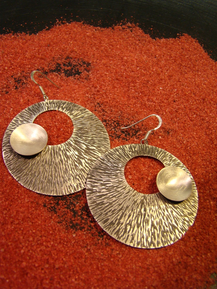 silver earrings with patina