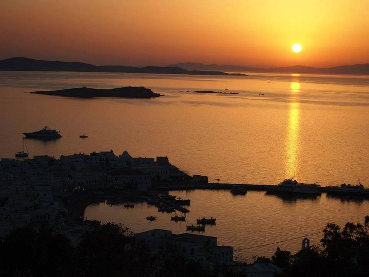 Mykonos sunset. Cosmopolitan and charming, the famous island of winds attracts every year thousands of visitors all over the world.