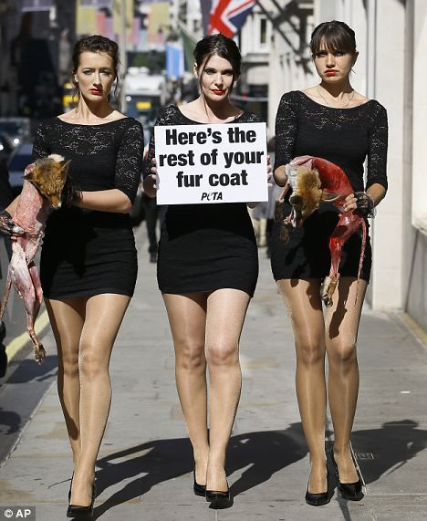 Here is the rest of your fur coat: Peta protestors dressed in LBDs parade dead, skinned foxes on Bond Street on the eve of London Fashion Week