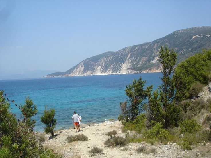 Afales is a bay at the north side of Ithaca, with a variety of beaches for every taste: from pebbles, white sand and  turquoise waters to lush vegetation and impressive rock formations. #Greece #Ithaca #Terrabook #GreekIslands #Travel #GreeceTravel #GreecePhotografy #GreekPhotos #Traveling #Travelling #Holiday #Summer