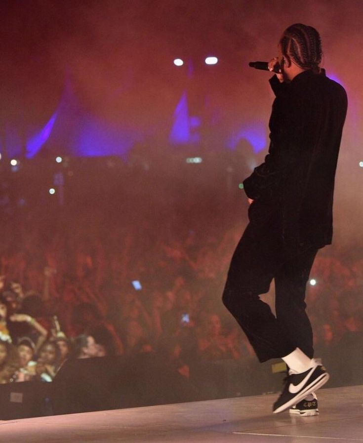 Kung-Fu Kenny and his custom 'CPT (Compton)' Nike Cortez' at Coachella