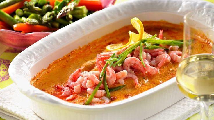 Fiskelycka i form! Fin smak av tomat och dill får den här gratängen med torsk och räkor.