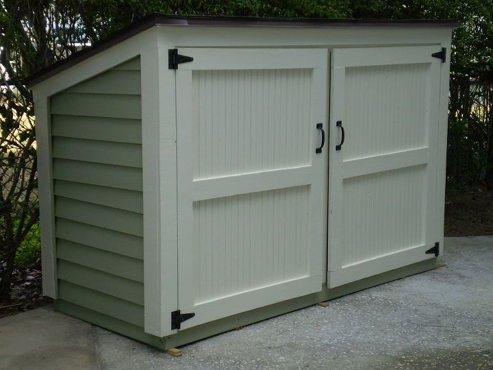 small outdoor storage, cleaning organization, outdoor living, Hide trash cans or recycling bins