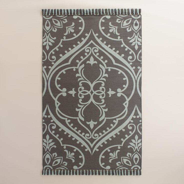 Crafted from recycled plastic bottles  our earth conscious area rug features our exclusive gray tapestry design with handmade tassels  www worldmarket com  WorldMarket Outdoor Entertaining
