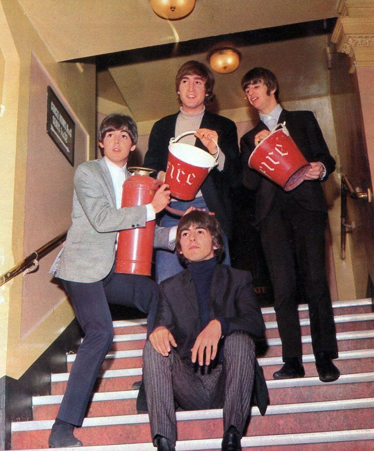 8th November 1964. Local boys done good as The Beatles clown around backstage at the Liverpool Empire,