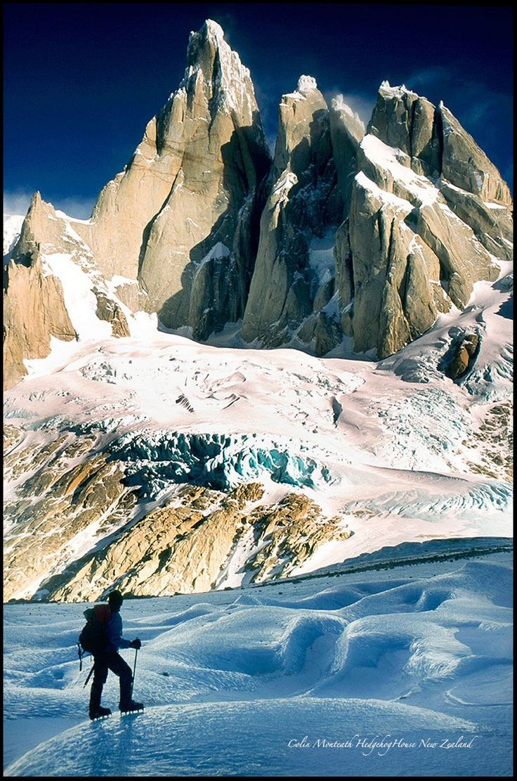 Climber under Cerro Torre - Patagonia - The day started innocently enough with a walk across Lago Torre in the dark....our crampon scratch marks from the recce the day before just visible in  torch beams...when suddenly wham, the ice broke... we were both underwater... then dog-paddling with heavy boots/crampons and packs. Thankfully we each had an ice axe and metal self arrest blade on a ski pole so could claw our way out onto solid ice. It was such a perfect windless winter day that we…