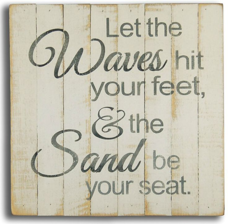 """Square off white beach house sign with colored simple quote """"""""Let the waves hit your feet, & the sand be your seat"""""""".These signs are made from rough slats pieced together to form the top of the box."""
