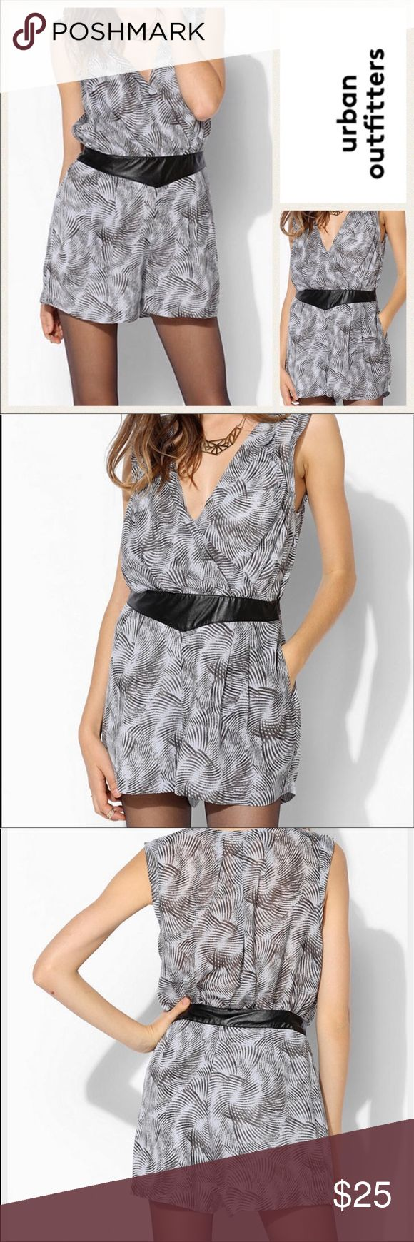 """Urban Outfitters Black & Grey Print Romper NWT.  Silence + Noise for Urban Outfitters black & grey print romper.  Silence +Noise is a label exclusive to Urban Outfitters.   Model photos and logo are Internet stock photos. All other photos are of actual romper. Measurements are as follows and approximate, taken while garment was laying flat.   Underarm to underarm: 20"""". Shoulder to hem of romper shorts:  29"""". Urban Outfitters Shorts"""