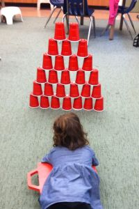 use stacking  cups to work on gross motor skills, not just fine motor skills