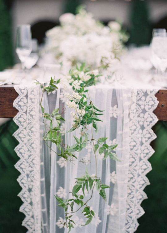 Dainty table runner decorated with little vines.