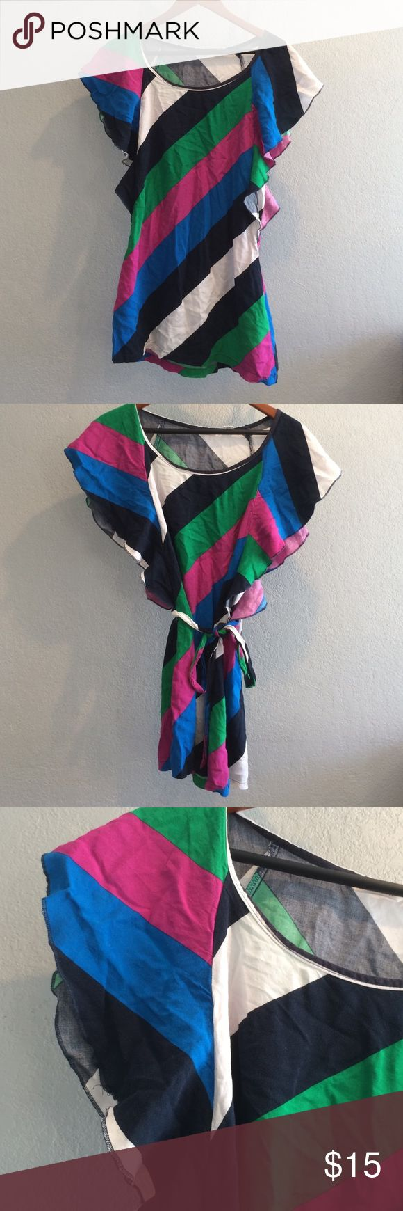 This is a colorful short short dress Very short mini dress- ties with that colorful strong- good condition- nicely worn Derek Heart Dresses Mini
